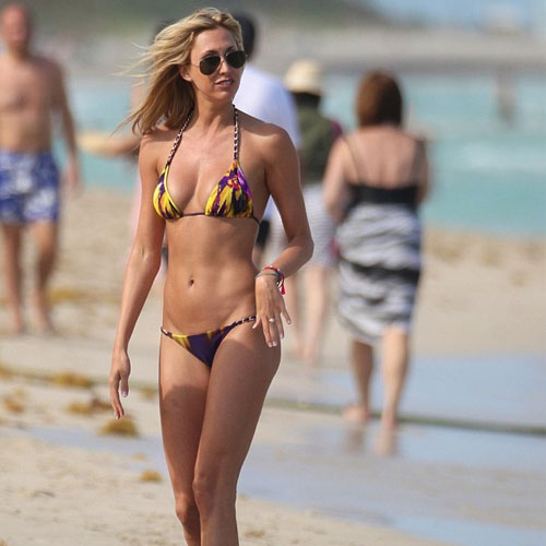 Lauren rocks Miami Beach in floral bikini  , lauren stonner,  lauren stonner with her boyfriend on miami beach,  sexy tie and die bikini,  hollywood news,  hollywood gossips,  latest news,  lauren looking sexy in purple and yellow chain strip bikink