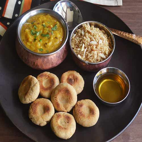 Give yourself Rajasthani treat with Dal Bati and Churma, give yourself rajasthani treat with dal bati and churma,  dal bati and churma recipe,  rajasthani dish dal bati and churma,  how to cook dal bati and churma,  easy recipe to dal bati and churma,  ifairer