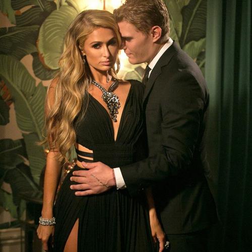 Paris Hilton caught kissing with new beau