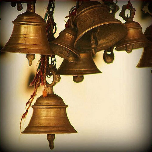Why do Hindus ring the bell in temple