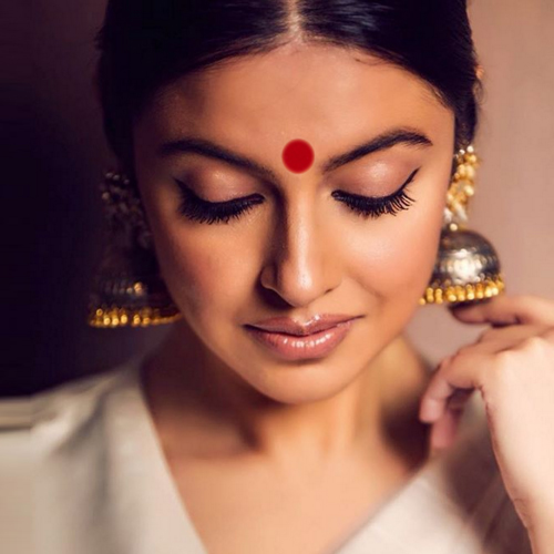 Why do Indian women wear bindi on their forehead