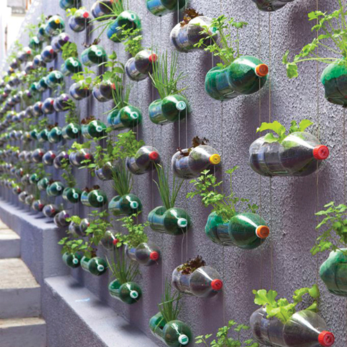 Unique Garden Ideas make a vertical garden with tiny planters mounted on a fence Unique Gardening Ideas Cadagu Garden Idea