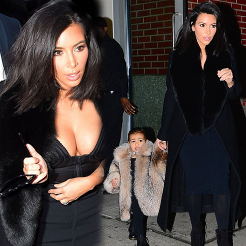 Kim wraps North but exposed own cleavage