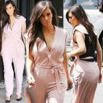 Kim displays her curves in PINK jumpsuit!
