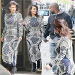 KIM goes hand in hand in embellished dress